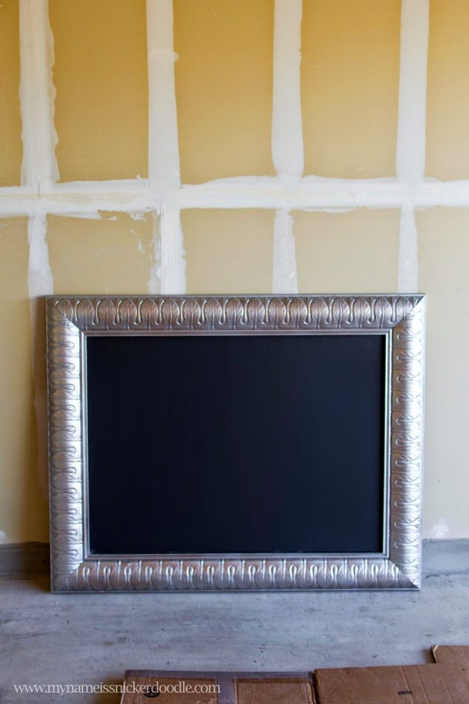 hereu0027s how to turn an old painting into an adorable framed chalkboard my name