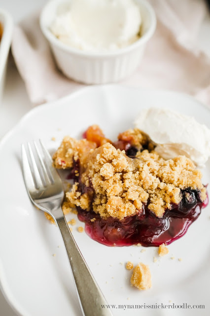 This gorgeous Peach and Blueberry Crisp will be perfect for any summer party! The recipe uses fresh fruit and is super easy! | mynameissnickerdoodle.com