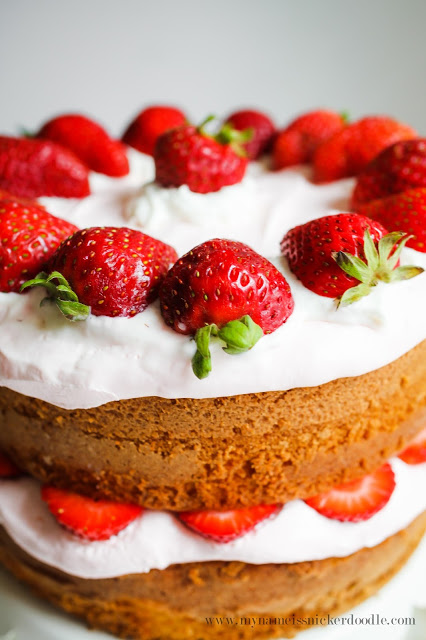 "Gorgeous!  This Strawberry Lemonade Cake has a tangy whipped cream ""frosting"".  The fresh strawberries and lemon cake make it all that much better!  
