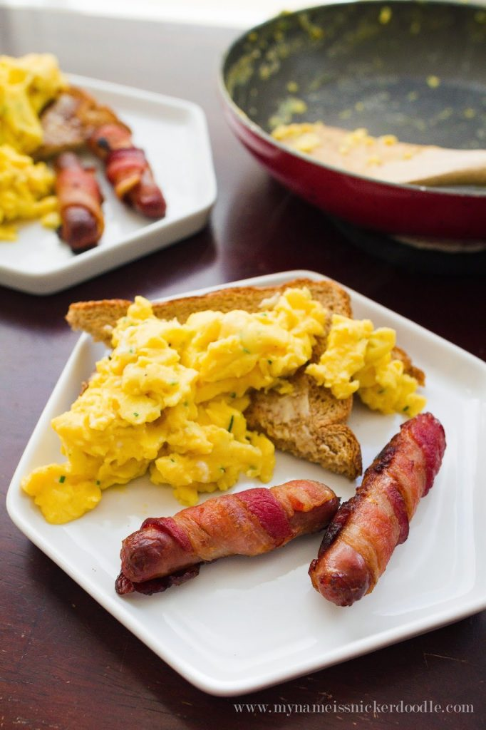 I didn't think breakfast could get any better! Chive Scrambled Eggs with Bacon Wrapped Sausage. Find the recipe at My Name Is Snickerdoodle