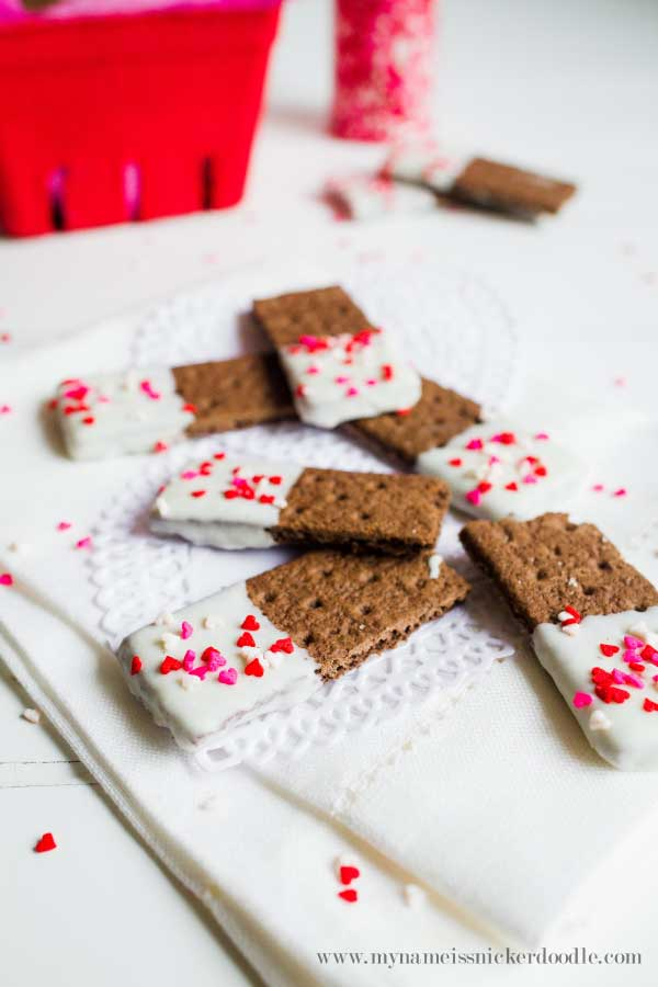 These Valentine Graham Cracker Cookie Sticks are completely easy to make and totally adorable! A perfect little treat. There's a surprising ingredient, too! Find the how to at mynameissnickerdoodle.com