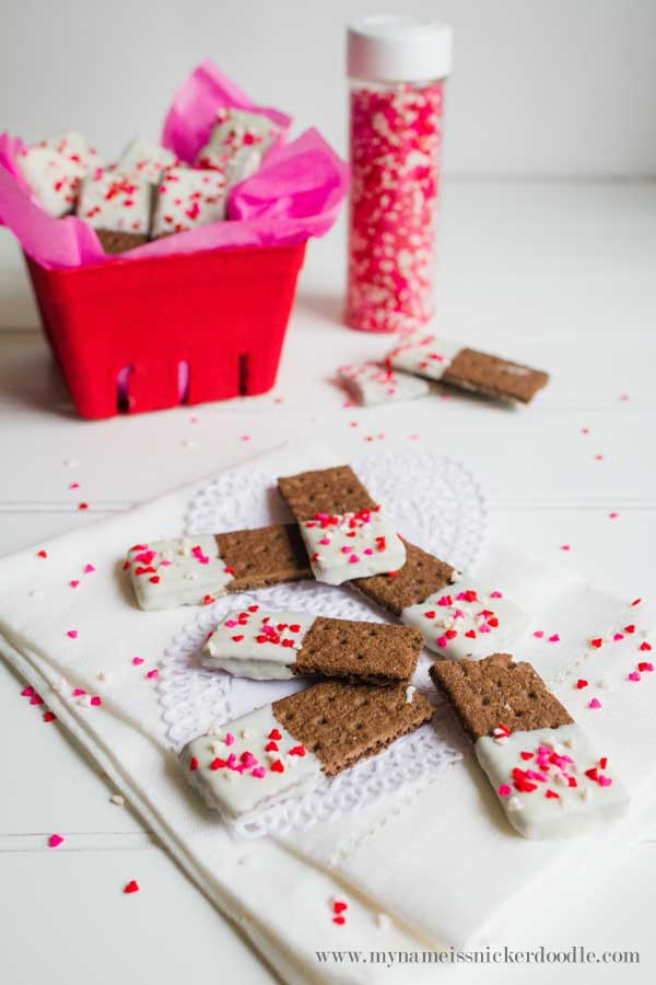 These Valentine Graham Cracker Cookie Sticks are completely easy to make and totally adorable! There's a surprising ingredient, too! Find the how to at mynameissnickerdoodle.com