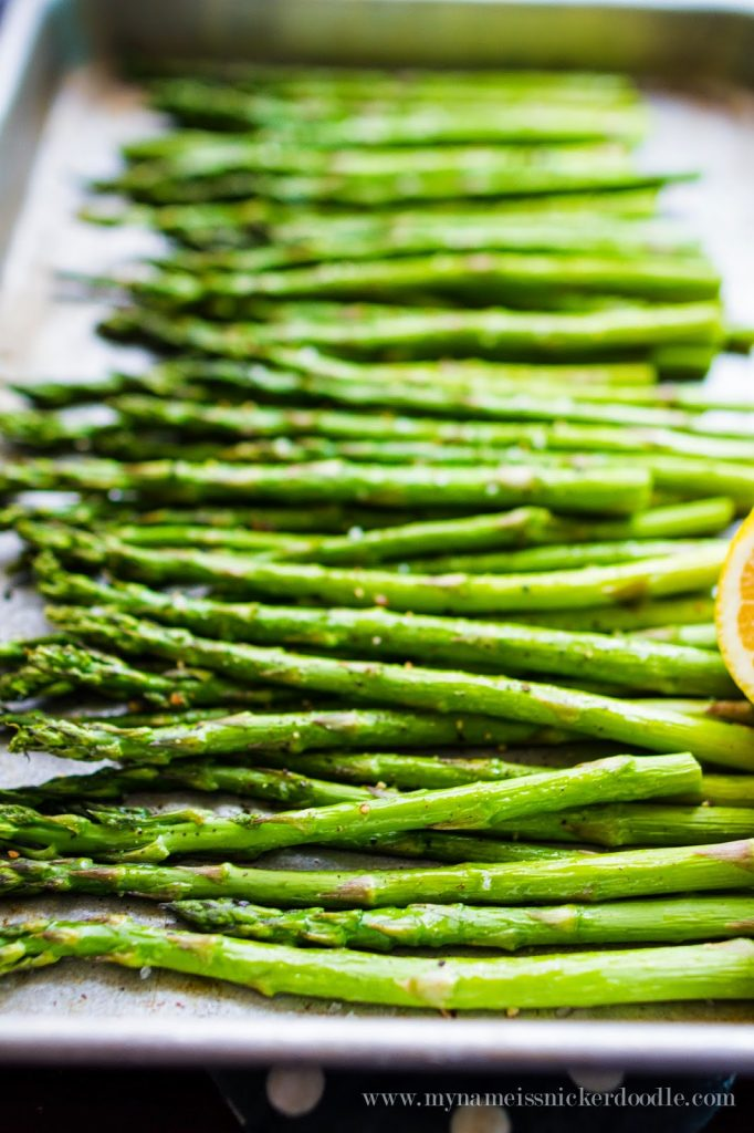 Totally easy and simple roasted asparagus that only takes minutes to prepare and cook! It's perfect side dish for an Easter or Sunday meal. | mynameissnickerdoodle.com