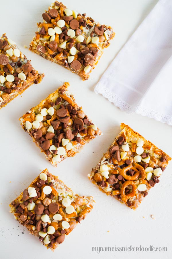 Here is a twist on the classic Magic Cookie Bars recipe.  These Magic Caramel Pretzel Cookie Bars are the perfect salty sweet treat!  |  mynameissnickerdoodle.com