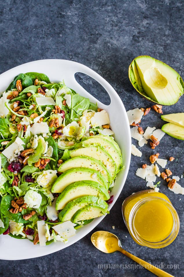 Super delicious recipe for Shredded Brussel Sprouts and Pecan Salad  served with a citrus garlic salad dressing of course with a little avocado!  |  mynameissnickerdoodle.com